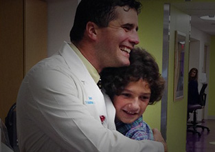 Dr. Ian Mitchell reunites with patient Michael Dominguez